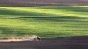 Tractor cultivates the field in the spring stock video