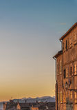 Sunset light over old buildings in Volterra Stock Image