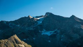 Sunset light over retiring dying glaciers on the Italian French Alps. Climate change concept. Royalty Free Stock Photo