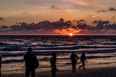 KLAIPEDA, LITHUANIA - AUGUST 19, 2017: Sunset Light with People and Shadows. Sunset at Baltic Sea Beach stock images