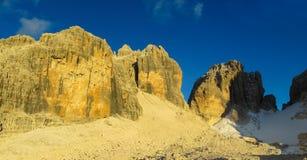 Sunset light at rocky mountain pass Dolomiti di Brenta, Italy. Beautiful rocky mountains in summer with blue sky. Beautiful rocky peaks, mountain and gray stones royalty free stock photography