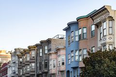 Sunset light shines on a row of colorful buildings on Filbert St. Reet in San Francisco, California Stock Images