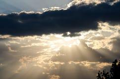 Sunset light throw deep clouds Royalty Free Stock Photography