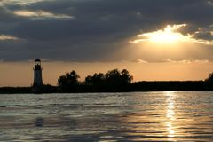 Sunset and lighthouse Stock Photography