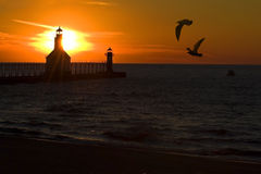 Sunset  Lighthouse. St. Joseph North Pier Lights in St. Joseph, Michigan at sunset Royalty Free Stock Photos