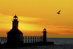 Sunset  Lighthouse. St. Joseph North Pier Lights in St. Joseph, Michigan at sunset Stock Image