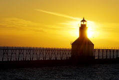 Sunset  Lighthouse. St. Joseph North Pier Lights in St. Joseph, Michigan at sunset Stock Images