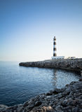 Sunset at the lighthouse. Of Artrutx cape, Menorca, Spain Royalty Free Stock Photography