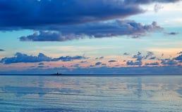 Sunset and lighthouse Stock Photos