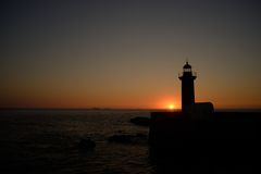 Sunset and Lighthouse Stock Images