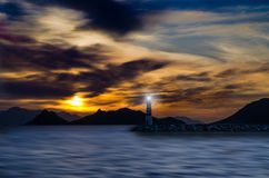 Sunset and lighthouse Royalty Free Stock Image