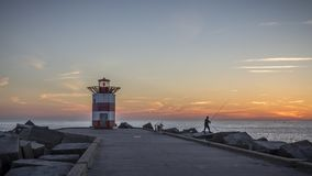 Sunset at the lighthouse  scheveningen beach The Hague Royalty Free Stock Photography