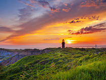 Sunset at a lighthouse Stock Image