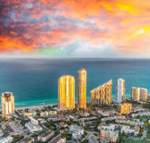 Sunset lights over Miami Beach buildings, helicopter view.  Royalty Free Stock Images