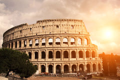 Sunset lights the side of ancient amphitheater Colosseum, Rome,. A beautiful sunset lights the side of ancient amphitheater Colosseum, Rome, Italy. Photo toned Royalty Free Stock Photography