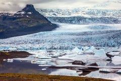 Sunset lights up the glacier Vatnajokull. Glacier provides water Ice Lagoon Jokulsarlon. Vatnajokull, Iceland's largest glacier. Sunset lights up the glacier royalty free stock image