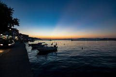 Sunset in Limenas town on Greek island Thassos royalty free stock images