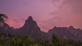 Pink Sunset at Limestone Mountain Tropical Area Timelapse. Khao Sok, Thailand. Sunset at Limestone Mountain Tropical Area Timelapse shot with a Sony a6300 fps29 stock video