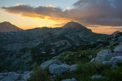 Sunset in limestone mountains Stock Image