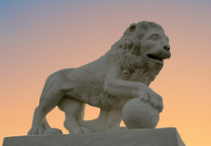 Sunset lion-3. Monument to a lion on a background of a sunset Royalty Free Stock Images