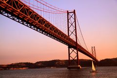 Sunset in Lisbon. Bridge 25 de Abril in Lisbon, at the sunset royalty free stock photography