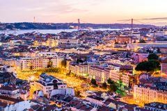 Sunset in Lisbon from the Senhora do Monte viewpoint. Aerial view of Lisbon from the Senhora do Monte viewpoint, located in the Graça neighborhood, Portugal Stock Images