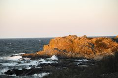 Photo of yellow rock lit by the sunset royalty free stock image
