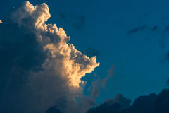 Sunset lit up relief cloud Stock Images