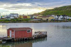 Sunset at little red dock house in village community of Twillingate, Newfoundland. stock photos