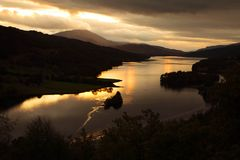 Sunset on a loch. Sunset on the Queen's way around Pitlochry, Scotland, UK Royalty Free Stock Photography