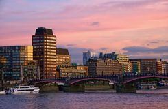 Sunset London. Sunset over Lambeth bridge and river Thames with illuminated skyline in background, London, England Stock Photography