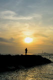 Sunset with lonely woman Royalty Free Stock Photo