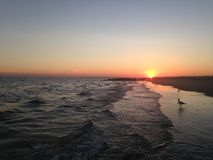 Sunset on Coney Island Beach. Royalty Free Stock Photography