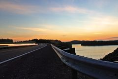 Sunset Long Exposure with Headlights. Sunset long exposure over Summersville Dam with car headlight trail Royalty Free Stock Photography