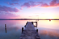 Sunset on long jetty at lake Stock Image