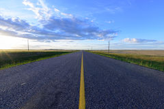Sunset on a long road Royalty Free Stock Image