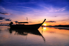 Sunset with long tail boat on Ao Nang beach Thailand Stock Image