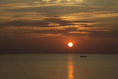 Sunset with long tailed boat Royalty Free Stock Image