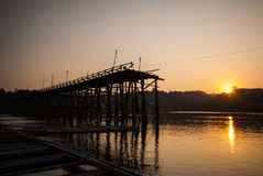 Sunset at the longest wooden bridge and floating Town in Sangkla. Buri Kanchanaburi Thailand Royalty Free Stock Photo