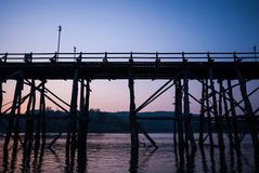 Sunset at the longest wooden bridge and floating Town in Sangkla Stock Photos