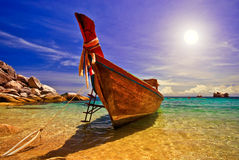 Sunset with Longtail Boat. Traditional Thai Longtail Boat at Sunset royalty free stock images