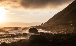 Sunset at the Lost Coast in California. Lighthouse on the beach, evening mood Stock Images