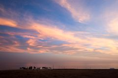 Sunset and lost property on the Pacific Coast stock photos