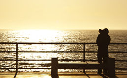 Sunset lovers. A couple huging by the sunset Stock Photography