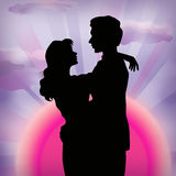 Sunset and lovers. Silhouette of loving couple on the crimson background royalty free illustration