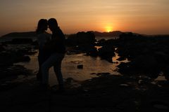 Sunset Lovers. Lovers beside the beautiful sunset stock photography