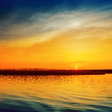 Sunset with low sun over river Stock Photo