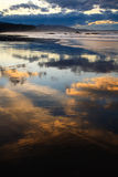 Sunset in low tide Stock Images