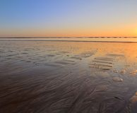 Sunset at low tide Royalty Free Stock Photo