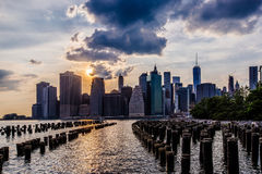 Sunset at Lower Manhattan Skyline, New York United States. Cloudy day sunset at Lower Manhattan Skyline view from Brooklyn Bridge Park, New York United States Royalty Free Stock Photography